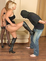 Two raunchy half-naked women giving humble guy a good kicking in the nuts
