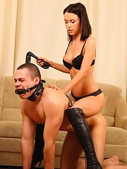 Horny domina goes for a ride on her pony boys back while whipping his ass